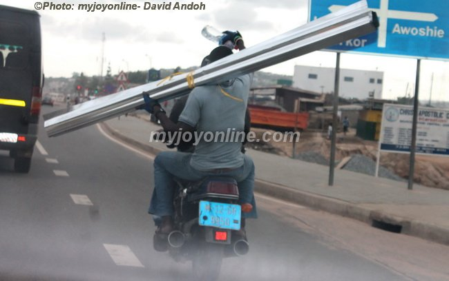 carpenter with stuffs on motorbike
