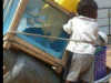afican child on shopping cart