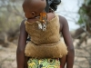 girl carrying little brother