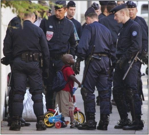 French police with a child