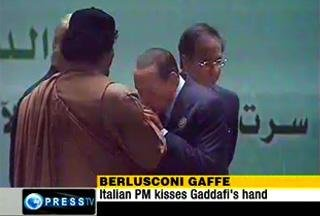berlosconi kissing qaddafi