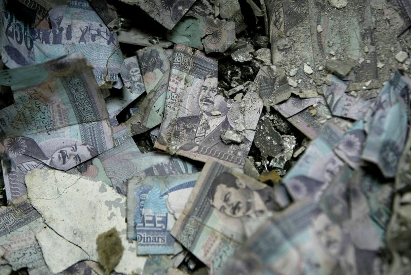 burned iraq currency at the central bank