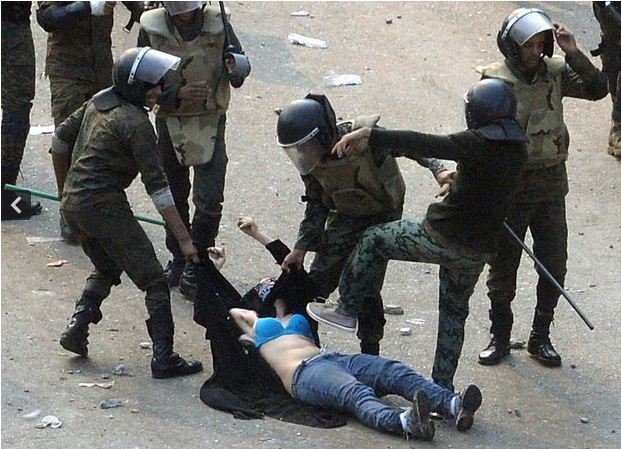 egyptian police beat protester