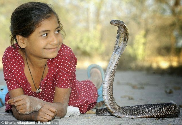 indian girl with her pet cobra