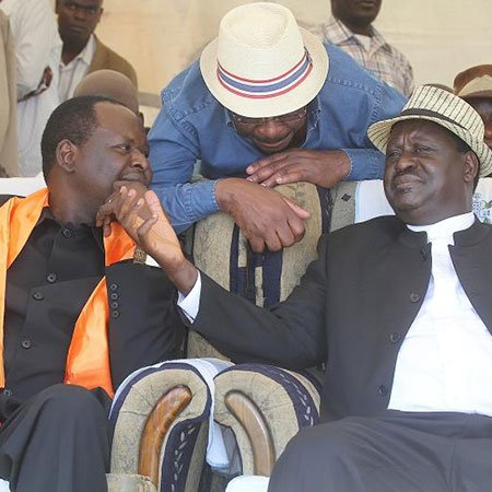Former Prime Minister Raila Odinga (right) consults with Siaya Senator James Orengo