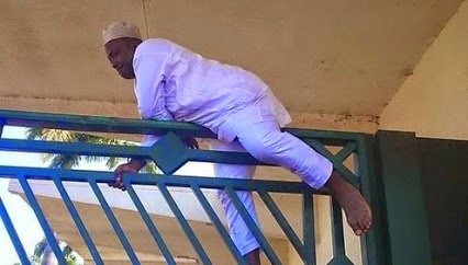 nigerian mp jumping  a fence