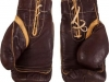 Auction Prices Realized Muhammad Ali's Gloves Worn vs. Sonny Liston (1st fight) Sell for a record $837,000.00.