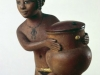 NUBIAN GIRL CARRYING A COSMETIC JAR, C. 1350 B.C. BOXWOOD WITH PIGMENT AND GOLD LEAF. ORIENTAL MUSEUM, DURHAM UNIVERSITY, U.K.