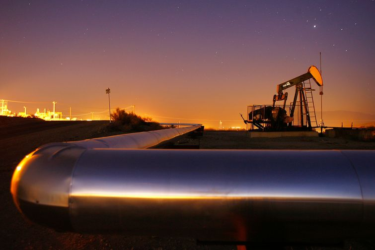An oil rig south of town extracts crude on July 21, 2008 in Taft, California.