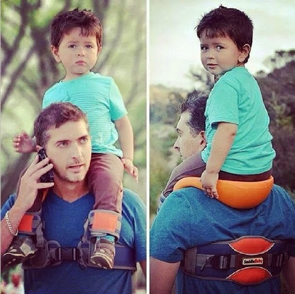 father carrying child