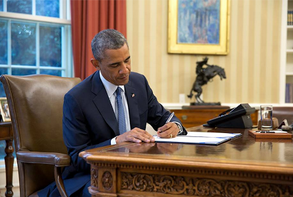 obama signing a doc