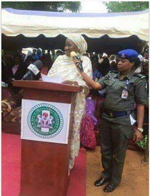 police officer hold mike for kebbi governor wife
